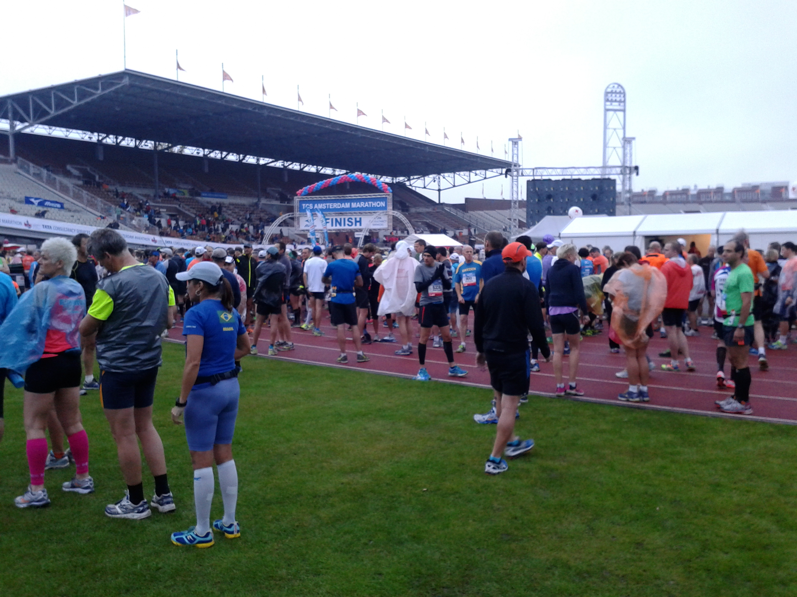 Runners inside Amsterdam Olympic stadium