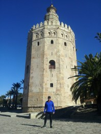 Picture of a runner in front of a tower